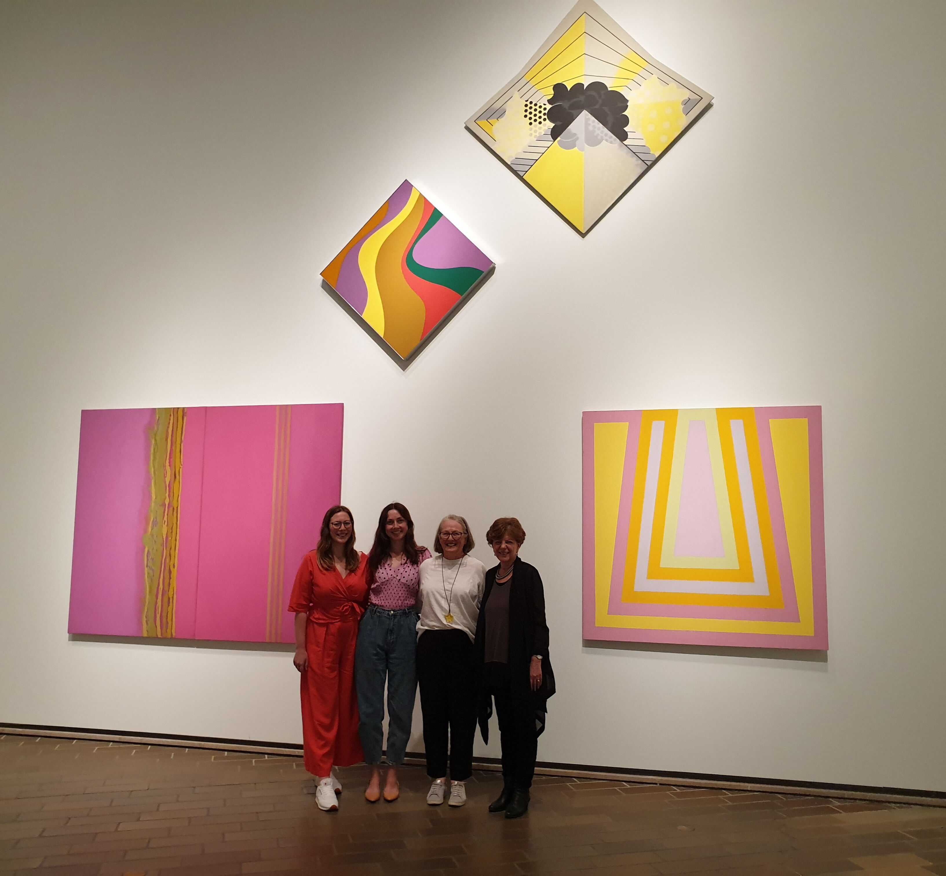 'Sukhavati No. 5' by Margret Worth in the exhibition 'Know My Name'.Curators R to L: Dr. Deborah Hart, (artist MW), Elspeth Pitt, Yvette Dal Pozzo beneath 'Sukhavati No. 5' in the exhibition of Australian women artists 1900 to 2020