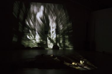 Collaboration with performance, projected images, collected stories and a stage set of ancient alluvial sands and river stones.