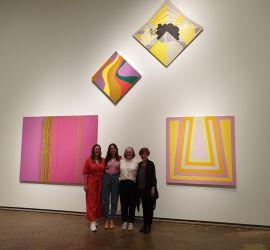 Curators R to L: Dr. Deborah Hart, (artist MW), Elspeth Pitt, Yvette Dal Pozzo beneath 'Sukhavati No. 5' in the exhibition of Australian women artists 1900 to 2020